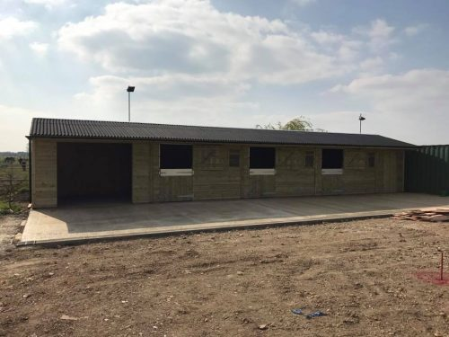 Block of 3 x 12 x 12 stables, 12 x 12 washroom and 6 x 12 tack room